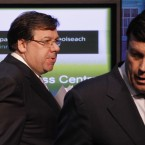 Brian Cowen leads Brian Lenihan off stage after announcing Ireland's bailout application last night. AP Photo/Peter Morrison