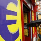 A woman enters a euro discount store in south Dublin. The euro initially rallied, but later slid, against foreign currencies as investors disregarded the benefits of an Irish bailout. (AP Photo/Peter Morrison)