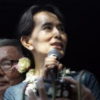Myanmar pro-democracy leader Aung San Suu Kyi delivers speech to supporters at the headquarters of her National League for Democracy Party Sunday, Nov. 14, 2010, in Yangon, Myanmar.  