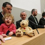 Daisy Gogarty (18 months) yawns in the arms of Green Party TD Paul Gogarty as leader John Gormley (far right) gives a press conference calling for a general election.