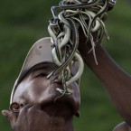 A street magician swallows a snake in Antananarivo, Madagascar Monday, Nov. 22, 2010, as he performs and later pulls them out. Since Madagascar gained independence from France in 1960, soldiers have repeatedly meddled in politics, and most Malagasy, as the nation's people are known, live in poverty, which ecotourism, vanilla production and the recent discovery of oil have done little to alleviate.