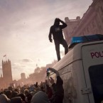 Students smash up a police van in central London as thousands gather in the capital in a demonstration against student fees.