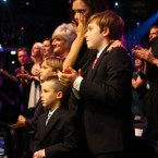 Victoria wipes away a tear as onstage, Beckham struggles with his emotions.