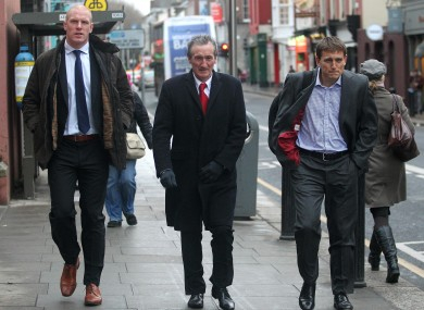 Munster's Paul O'Connell arrives for this morning's hearing with Munster Rugby PRO Pat Geraghty and team manager Shaun Payne