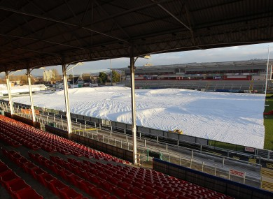 Groundstaff at Ravenhill work against the elements yesterday in preparation for the game against Bath tomorrow.