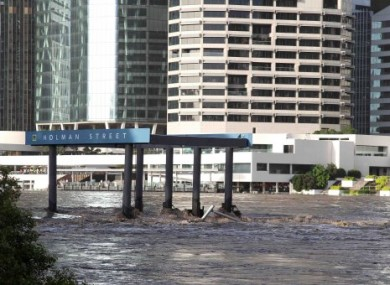 The Holman Street ferry is submerged by water flowing down the Brisbane River in Brisbane, Australia.