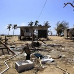 A beach-side house is destroyed in Tully Heads, Australia, 5 February, 2011, after Cyclone Yasi. (AP Photo/Rick Rycroft)