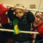 Little Billy Kelleher helps his dad, Fianna Fail candidate Billy Kelleher Snr, do the rounds at the Glen Boxing Club in Cork city.