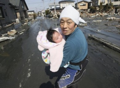 Upon hearing of new tsunami warning, a father tries to flee to safety with his just-reunited four-month-old daughter.