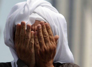 An anti-government protester prays in  Bahrain yesterday. Irish citizens have been advised not to travel to the country unless absolutely necessary.