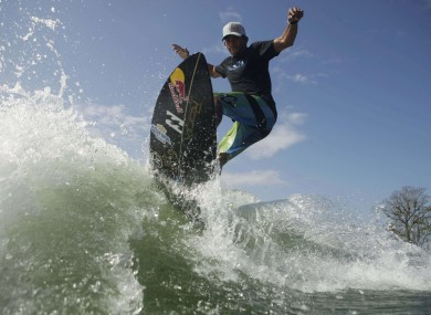 Panama's surfing champion Gary Saavedra rides a wave created by a wakesurfing boat during a training session at the Chagres river on Monday.