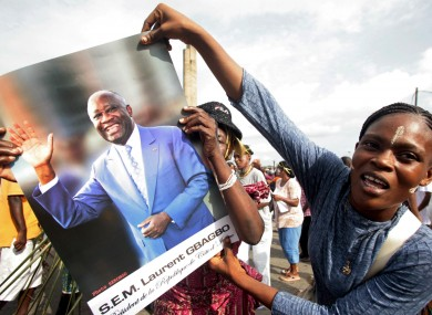 A woman shows her support to incumbent Ivory Coast President Laurent Gbagbo during a rally in Abidjan