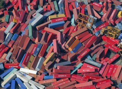 File photo of cargo containers strewn about in Sendai, Japan following the tsunami last month.