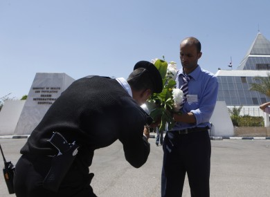 An Egyptian policemean checks flowers to be delivered to former President Hosni Mubarak from an Egyptian citizen earlier this week.