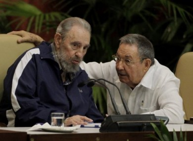 Fidel Castro, left, and Cuba's President Raul Castro attend the 6th Communist Party Congress in Havana, Cuba, today.