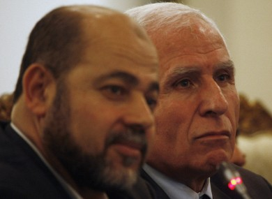 Chief Fatah negotiator in reconciliation talks Azzam al-Ahmed, right, and Hamas leader Moussa Abu Marzoug, left, look on during a news conference in Cairo, Egypt on Wednesday.