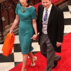 Samantha Cameron takes off her jacket and holds hands with husband, British Prime Minister David Cameron, when the ceremony is over.