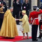 The Dean of Westminster and Queen Elizabeth II have a clash of the canaries.