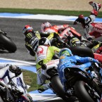 MotoGP rider Mapfre Aspar Team, Hector Barbera, right, falls off his bike, during the first lap at the Portugal MotoGP Grand Prix at Estoril.