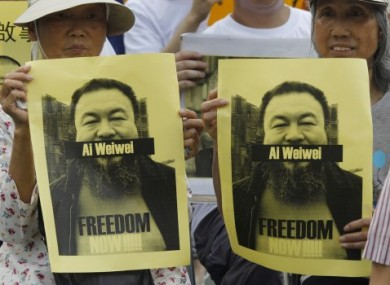 Pro-democracy protesters hold photos of detained Chinese artist Ai Weiwei at a demonstration in Hong Kong on 2 May.