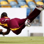 The West Indies' Dwayne Bravo catches Ahmed Shehzad's shot during the fourth one-day international cricket match against Pakistan in Bridgetown, Barbados.