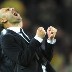 Barcelona coach Pep Guardiola celebrates during Tuesday's Champions League semi-final second leg against Real Madrid.