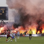 Hooligans light fires during the Polish Soccer Cup final between Legia Warszawa and Lech Poznan on Tuesday. The incident which brought €10,000 in damages prompted officials to call for tighter regulations to assure security during Euro 2012.