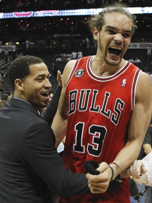 Joakim Noah (right) and Jannero Pargo react to the Bulls' win last night.