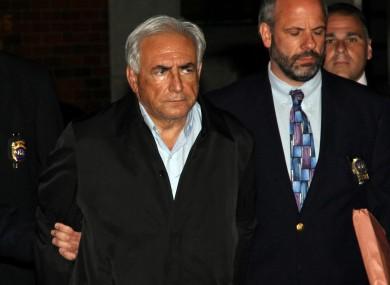 Strauss-Kahn is lead from a police station in New York on Sunday night.