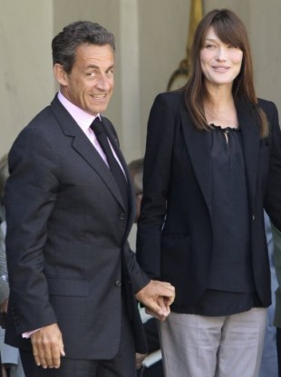 France's President Nicolas Sarkozy, and his wife Carla Bruni-Sarkozy, right, at the Elysee Palace in Paris, Friday, May 13