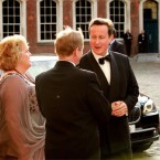British Prime Minister David Cameron greets Taoiseach Enda Kenny and his wife Fionnuala at Dublin Castle ahead of the state dinner. (Julien Behal/PA)