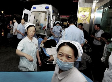 An injured man from a Foxconn factory, on a stretcher, arrives at a hospital in Chengdu in China's Sichuan province.