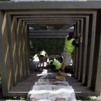 Gardeners work on a structure in the Tourism Malaysia Garden in preparation for the Chelsea Flower Show.