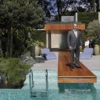 Monaco's Prince Albert II poses at the Monaco Garden at the Chelsea Flower Show.