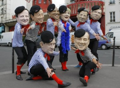 Members of Oxfam international wear G8 leaders masks to demonstrate against this week's summit in France.