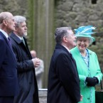 Queen Elizabeth II and the Duke of Edinburgh in the nave of the Cathedral at the Rock of Cashel, Co Tipperary, with Minister for Public Expenditure and Reform Brendan Howlin, second right, and Dr Eugene Keane of the OPW, second left. (Pic: Bryan O'Brien/Maxwells/PA Wire/Press Association)