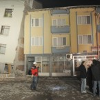 People outside their damaged houses after an earthquake measuring 5.9 magnitude late Thursday in Simav in northwest Turkey - three people were killed. (AP Photo)