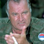 July 1995: The former Bosnian Serb wartime commander Mladic talks with the press near the eastern Bosnian enclave of Zepa.