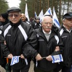 Jews march during a Holocaust memorial service in Vilnius, Lithuania, where Algimantas Dailide was convicted of aiding in the execution of 12 Jews. He served with the Lithuanian Security Police. 