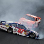 Bobby Labonte (47) spins as Joey Logano (20) avoids a collision during the NASCAR Coca-Cola 600 on Sunday.