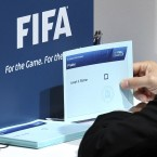 An assistant holds a ballot for the election of the FIFA President during voting at the Association's headquarters in Zurich on Wednesday.