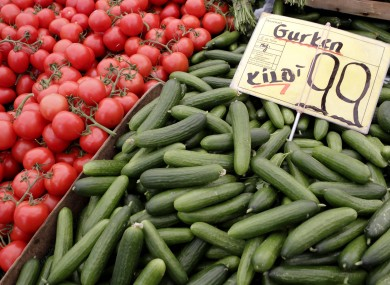 Tomatoes and cucumbers from Holland are displayed for sale at a market in Berlin. An EU lab has said there is no reason to suspect vegetables as being the source of the new E.coli outbreak.