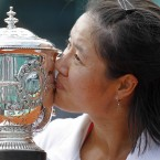 Li Na kisses the French Open trophy after becoming the first ever Chinese tennis player to win a Grand Slam title.