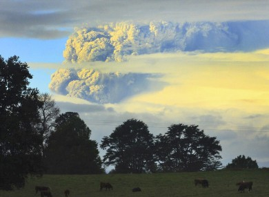 A column of smoke and ashes emerges from a volcano in southern Chile.