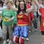 A lady dressed as wonder woman joins the 40,000 runners taking part in the Flora womens mini Marathon for Charities in Dublin today.