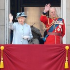 Britain's Queen Elizabeth II and the Duke of Edinburgh wave from the balcony of Buckingham Palace.
