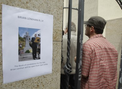 People queue to sign books of condolence at Brian Lenihan's constituency office in Castleknock Dublin. Lenihan died yesterday, aged 52