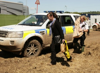 Police carrying bags of evidence into the hospitality area of the Glastonbury festival yesterday.