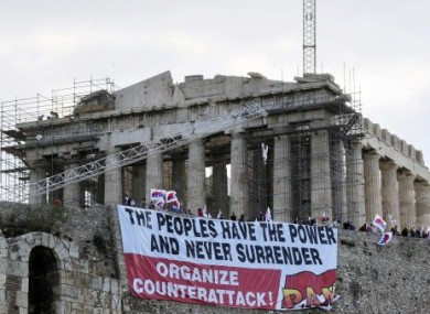 Anti-austerity demonstrators outside the Parthenon in Athens on Monday.