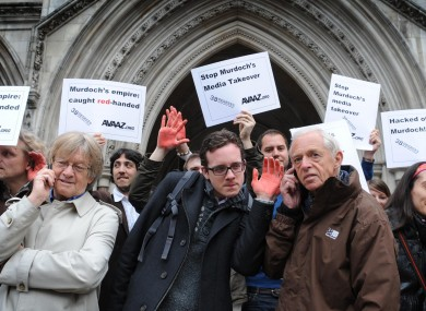 Demonstrators outside the High Court in London in April, where decisions were being made about the News of the World phone hacking case should proceed